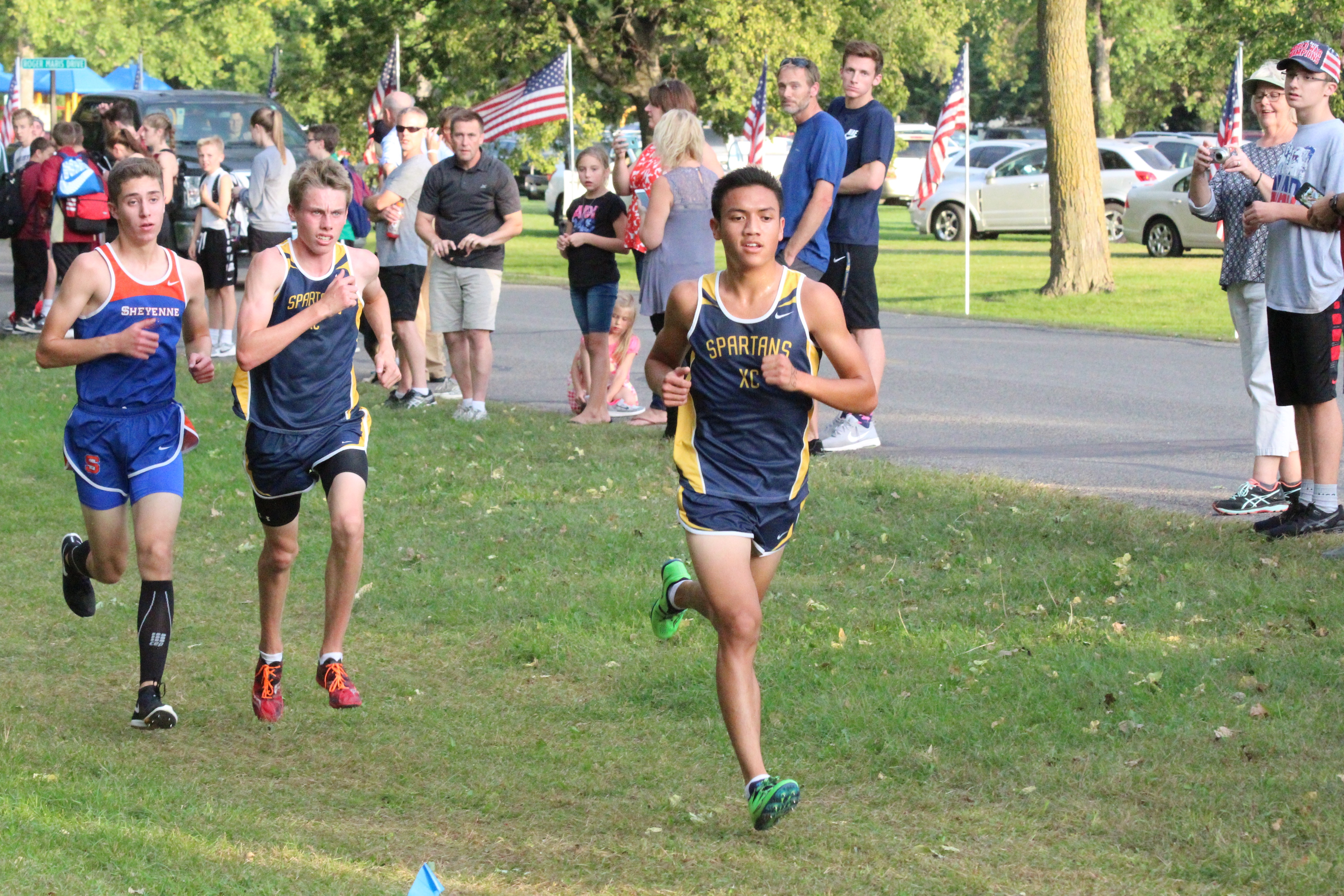 Anna Bernhardt cross country runners lineup to race at andrew nelson metro